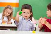 Boy Showing Clay At Classroom — Stock Photo