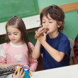 Children Playing Musical Instruments In Classroom — Stock Photo #25931387