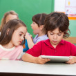 Children Using Digital Tablet At Preschool — Stock Photo #25936971