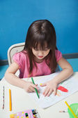 Girl Drawing With Sketch Pen In Classroom — Stock Photo