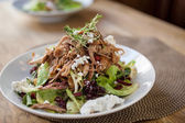 Garnished Chicken Salad At Table — Stock Photo