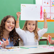 Teacher With Girl Showing Drawing At Desk — Stock Photo