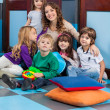 Teacher And Students Sitting On Floor In Classroom — Stock Photo