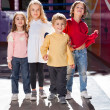 Boy Standing With Friends In Kindergarten — Stock Photo