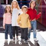 Boy Standing With Friends In Kindergarten — Stock Photo #26256707