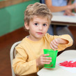 Little Boy Washing Paintbrush In Glass — Stock Photo