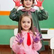 Boy And Girl Showing Colored Hands In Classroom — Stock Photo