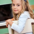 Girl With Laptop In Classroom — Stock Photo #26257537