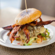 Delicious Bacon Burger On Plate — Stock Photo #26259457