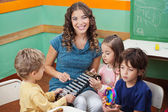 Teacher Playing Xylophone With Students In Preschool — Stock Photo