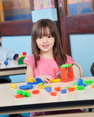 Girl Playing With Construction Blocks In Preschool — Stok fotoğraf