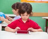 Boy Using Digital Tablet At Desk — Stock Photo