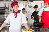 Confident Female Chef In Kitchen — Stock Photo