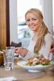 Young Woman Having Food At Coffeeshop — Stock Photo