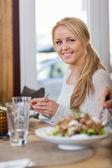 Young Woman Having Food At Coffeeshop — Stock Photo
