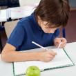Stock Photo: Schoolboy Copying From Cheat Sheet During Examination