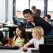 Female Teacher With Students At Desk — Stock Photo