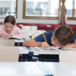 Boy And Girl Studying In Classroom - Stock Photo