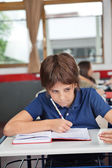 Schoolboy Cheating At Desk During Examination — Stock Photo