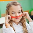 Girl Holding Mustache Made Of Clay In Classroom — Foto de Stock