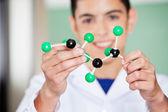Schoolboy Examining Molecular Structure In Lab — Stock Photo
