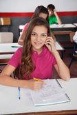 Portrait Of Schoolgirl Sitting At Desk — Stock Photo