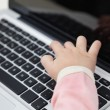 Stock Photo: Girl's Hand Typing On Laptop Keyboard