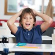 Shocked Little Boy With Globe And Books At Desk — Stock Photo