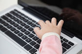 Girl's Hand Typing On Laptop Keyboard — Stock Photo