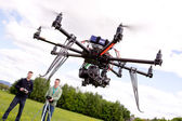 Photographer and Pilot with UAV — Stock Photo