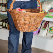 Low Section Of Man Holding Wicker Basket — Stock Photo #27169111