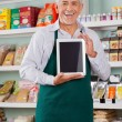 Male Owner Showing Digital Tablet In Store — Stock Photo