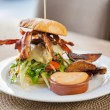 Bacon Burger on Plate in Restaurant — Stock Photo