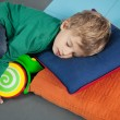 Stock Photo: Boy sleeping With Toy In Kindergarten