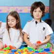 Boy With Female Friend Playing Blocks In Classroom — Stock Photo