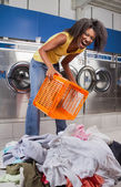 Woman Screaming While Holding Basket With Clothes On Floor — Stock Photo