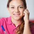 Teenage Schoolgirl In Classroom — Stock Photo #27240319