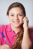 Teenage Schoolgirl In Classroom — Stock Photo