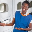 Stock Photo: Female Helper Welcoming In Laundry