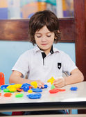 Boy Playing With Blocks In Classroom — Stock Photo