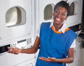 Female Helper Welcoming In Laundry — Stock Photo