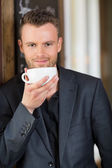 Confident Business Man Drinking Coffee — Stock Photo