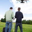Photographer and Pilot Operate UAV — Stock Photo #27305291