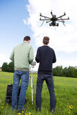 Photographer and Pilot Operate UAV — Stock Photo