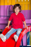 Little Boy Playing On Slide In Kindergarten — Stock Photo