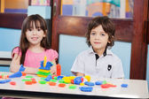 Cute Friends With Construction Blocks In Kindergarten — Stock Photo
