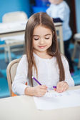 Girl Drawing With Sketch Pen At Desk — Foto Stock