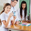 Schoolgirl With Molecular Structure At Desk — Stock Photo