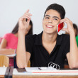 Male Student Looking Away While Talking On Phone — Lizenzfreies Foto