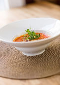Garnished Tomato Soup On Table — Stock Photo